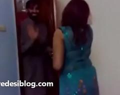 Punjabi girls gather up close by men enjoying