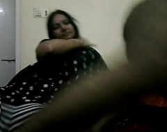 Tamil bhabhi in coloured indian saree giving her h...